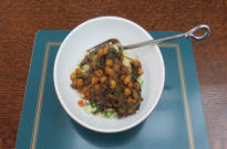Spinach and chickpea curry served with a simple couscous